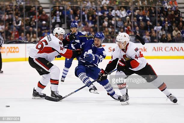 Toronto Maple Leafs Brendan Leipsic is knocked away from the puck by Ottawa Senators Patrick Wiercioch while Ottawa Senators JeanGabriel Pageau...
