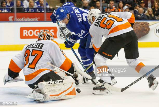 Toronto Maple Leafs center Auston Matthews can't control a rebound as Philadelphia Flyers center Valtteri Filppula moves in to check him and...