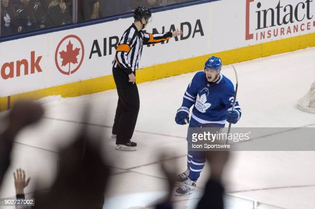 Toronto Maple Leafs Center Auston Matthews celebrates with fans a goal that was later disallowed by officials during the regular season NHL game...