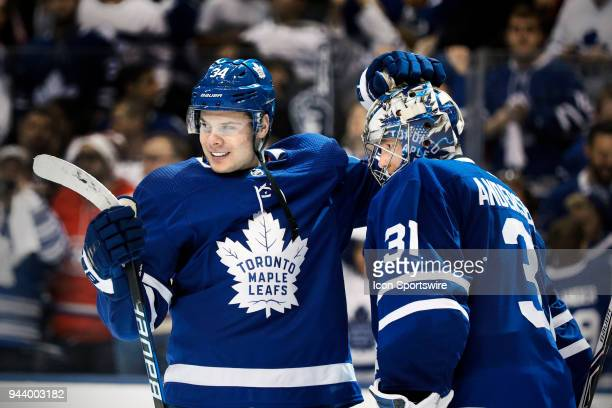 Toronto Maple Leafs Center Auston Matthews congratulates teammate Goalie Frederik Andersen as the team celebrates its 42 win after the final NHL 2018...