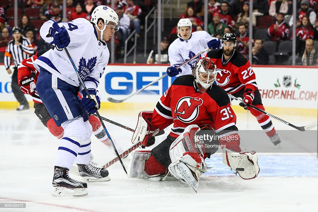 Toronto Maple Leafs center Auston Matthews (34) drives the net against New Jersey Devils goalie Cory Schneider (35) during the second period of the National Hockey League game between the New Jersey Devils and the Toronto Maple Leafs on November 23, 2016, at the Prudential Center in Newark, NJ.