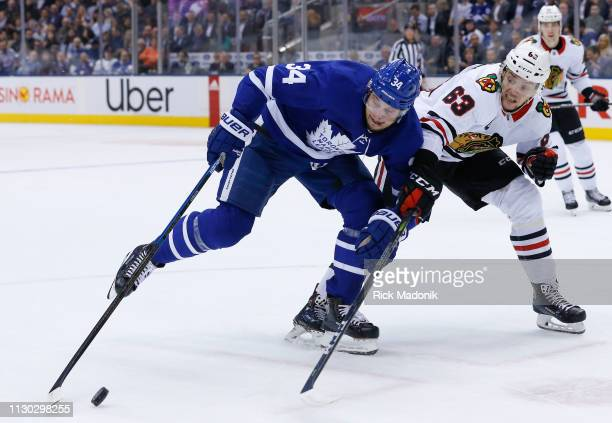 Toronto Maple Leafs center Auston Matthews has trouble controlling the puck as Chicago Blackhawks defenseman Carl Dahlstrom bears down on defence...