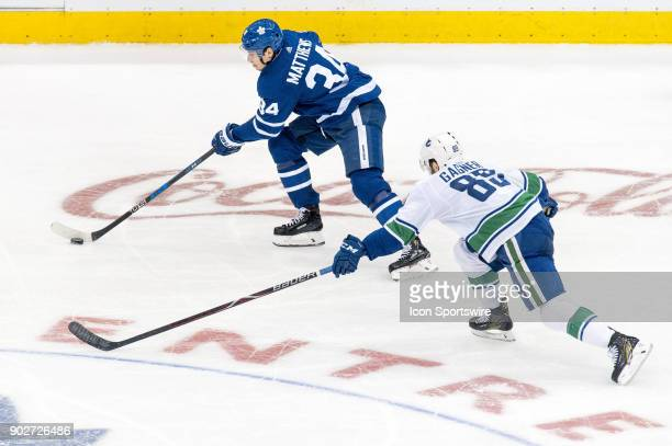 Toronto Maple Leafs Center Auston Matthews is chased by Vancouver Canucks Center Sam Gagner during the regular season NHL game between the Vancouver...