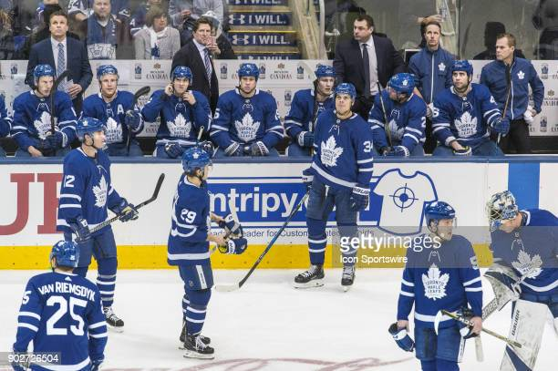 Toronto Maple Leafs Center Auston Matthews looks up at the clock down 2 goals during the regular season as teammates and coaching staff reflect...