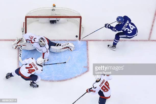 TORONTO ON APRIL 17 Toronto Maple Leafs center Auston Matthews puts the puck past Washington Capitals goalie Braden Holtby as the Toronto Maple Leafs...