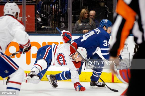 Toronto Maple Leafs Center Auston Matthews takes down Montreal Canadiens Right Wing Daniel Carr during the final NHL 2018 regularseason game between...