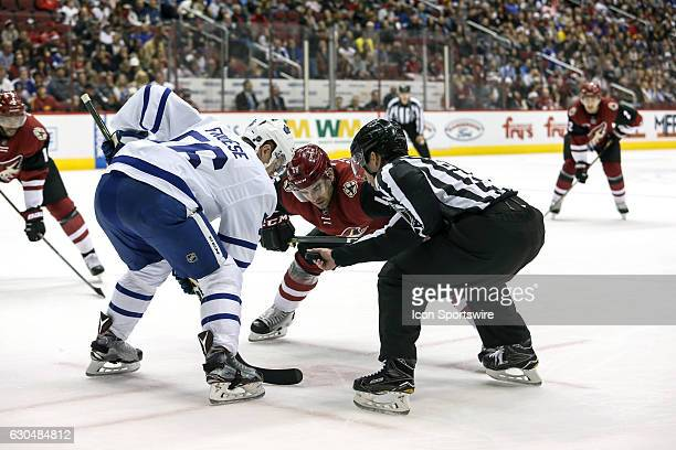 Toronto Maple Leafs center Byron Froese and Arizona Coyotes left wing Jordan Martinook face off during the NHL hockey game between the Toronto Maple...