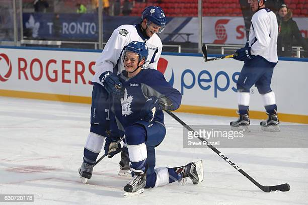 Toronto Maple Leafs center Byron Froese and Toronto Maple Leafs center William Nylander take a break as the Toronto Maple Leafs practice on the eve...