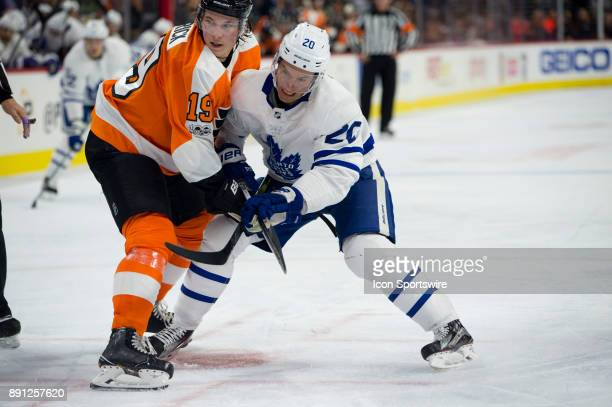 Toronto Maple Leafs Center Dominic Moore tries to get by Philadelphia Flyers Center Nolan Patrick after a faceoff in the second period during the...