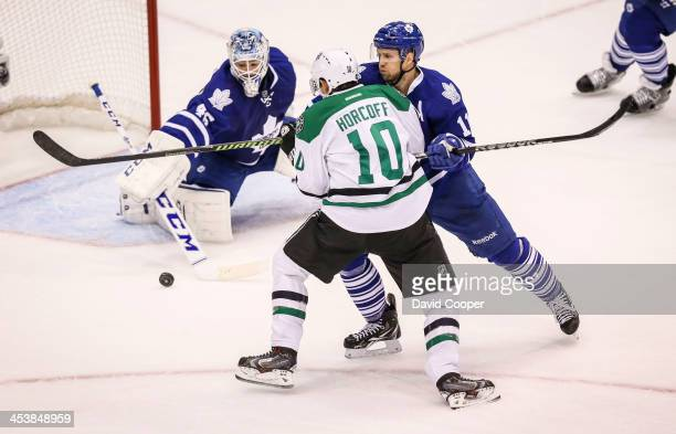 Toronto Maple Leafs center Jay McClement pushes Dallas Stars center Shawn Horcoff away from the puck in front of Toronto Maple Leafs goalie Jonathan...