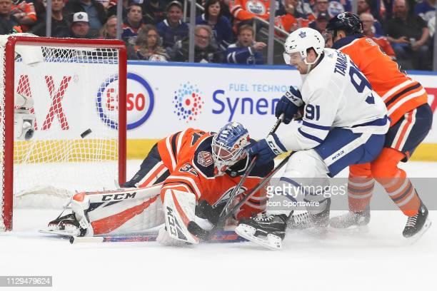 Toronto Maple Leafs Center John Tavares scores a goal on Edmonton Oilers Goalie Anthony Stolarz in the second period during the Edmonton Oilers game...