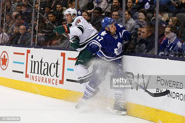 Toronto Maple Leafs center Leo Komarov misses on his check of Minnesota Wild defenseman Ryan Suter Toronto Maple Leafs V Minnesota Wild during 1st...