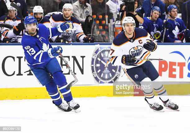 Toronto Maple Leafs center Nazem Kadri and Edmonton Oilers center Connor McDavid skate up ice in the first period during a game between the Edmonton...