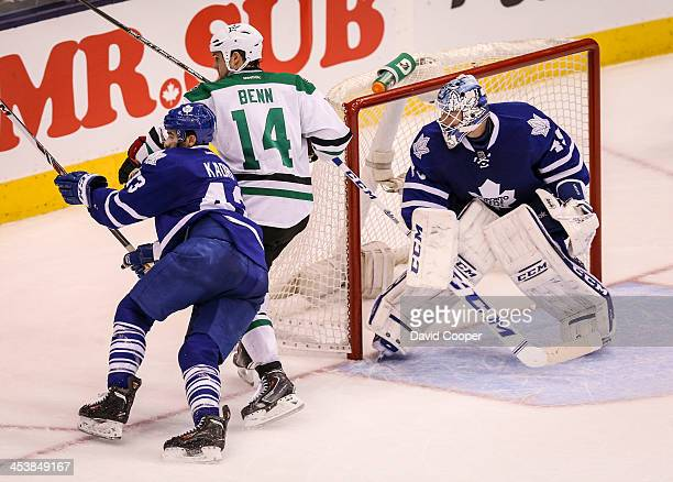 Toronto Maple Leafs center Nazem Kadri gets knocked down by Dallas Stars left wing Jamie Benn as they chase down the puck behind the Stars net during...