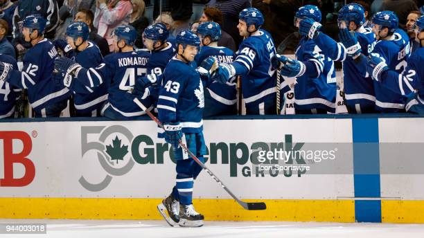 Toronto Maple Leafs Center Nazem Kadri is congratulated by Defenceman Roman Polak and other teammates on the Leaf's bench after his goal during the...