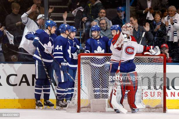 Toronto Maple Leafs Center Nazem Kadri is congratulated on his goal by teammates Left Wing James van Riemsdyk Defenceman Morgan Rielly and Right Wing...