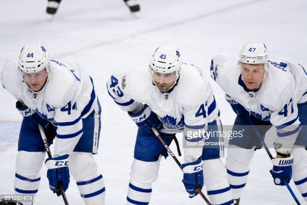 Toronto Maple Leafs Center Nazem Kadri stands with Defenceman Morgan Rielly and Right Wing Leo Komarov before a faceoff in the first period during...