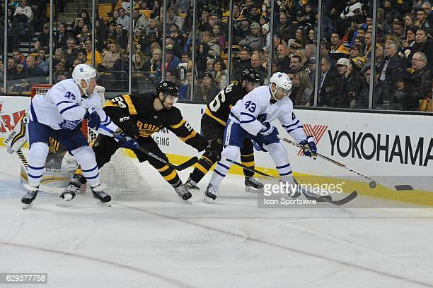 Toronto Maple Leafs Center Nazem Kadri tries to knock down the loose puck During the Toronto Maple Leafs game against the Boston Bruins on December...