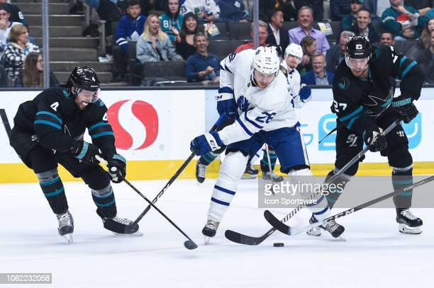 Toronto Maple Leafs Center Par Lindholm controls the puck under pressure from San Jose Sharks Defenceman Brenden Dillon and San Jose Sharks Right...