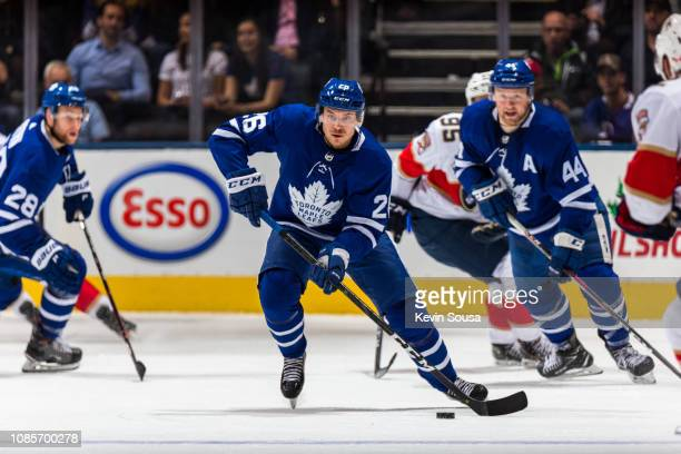 Toronto Maple Leafs center Par Lindholm skates with the puck against the Florida Panthers during the second period at the Scotiabank Arena on...