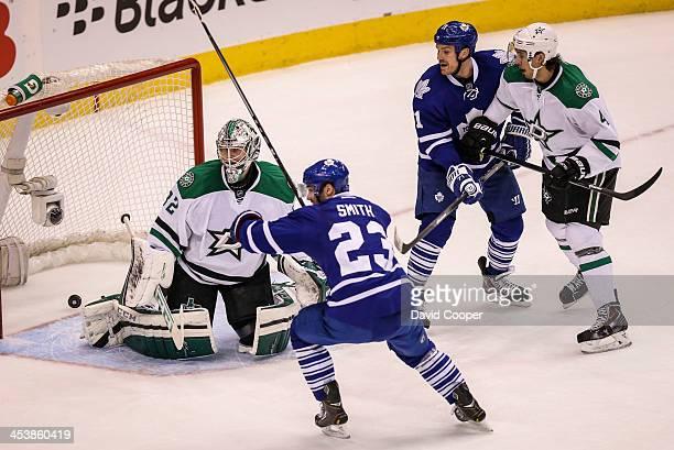 TORONTO ON DECEMBER 5 Toronto Maple Leafs center Trevor Smith prepares to celebrate his winning goal passed Dallas Stars goalie Kari Lehtonen as the...