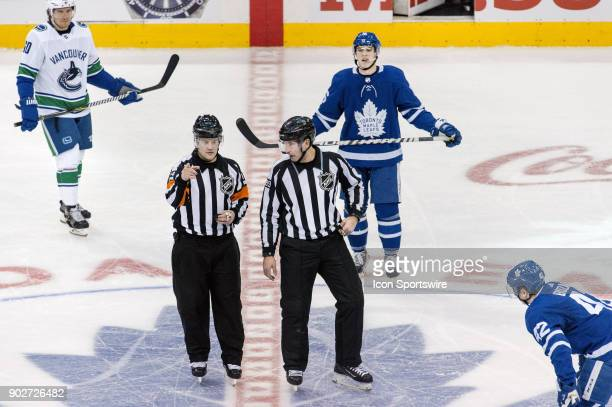 Toronto Maple Leafs Center Tyler Bozak and teammate Right Wing Mitchell Marner await a faceoff at centre as Vancouver Canucks Winger Markus Granlund...