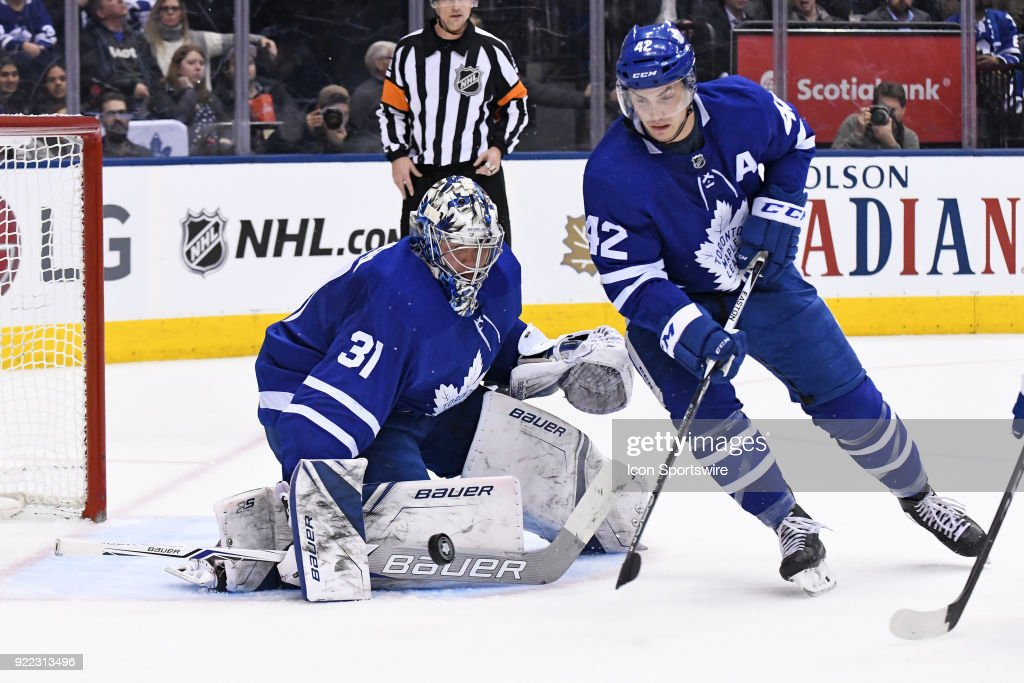 Toronto Maple Leafs Center Tyler Bozak (42) clears the puck in front of Toronto Maple Leafs Goalie Frederik Andersen (31) during the regular season NHL game between The Florida Panthers and Toronto Maple Leafs on February 20, 2018 at Air Canada Centre in Toronto, ON.