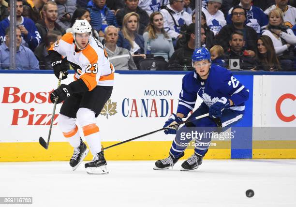 Toronto Maple Leafs center William Nylander and Philadelphia Flyers defenseman Brandon Manning chase down a puck in the second period during a game...