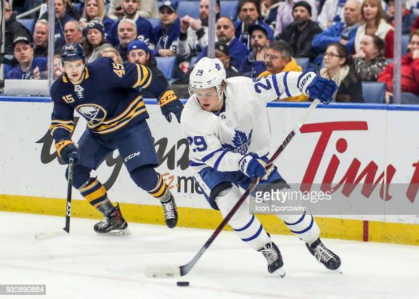 Toronto Maple Leafs center William Nylander carries the puck out the zone during an NHL game between the Toronto Maple Leafs Knights and Buffalo...