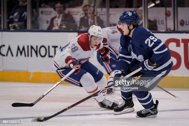 Toronto Maple Leafs Center William Nylander is checked by Montreal Canadiens Left Wing Nikita Scherbak during the regular season NHL game between the...