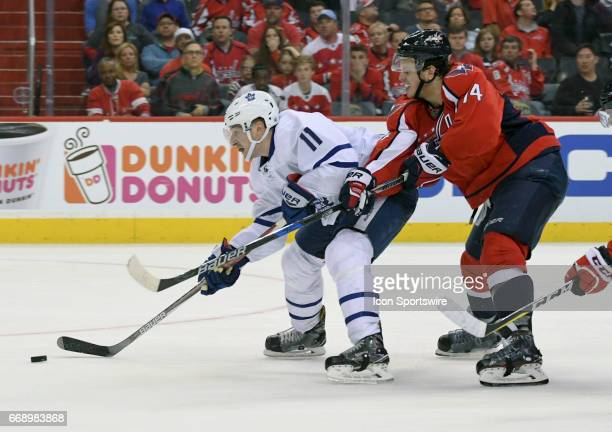 Toronto Maple Leafs center Zach Hyman attempts to score in the first overtime against Washington Capitals defenseman John Carlson on April 15 at the...