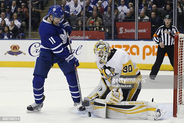 Toronto Maple Leafs center Zach Hyman can't get his blade on the puck which Pittsburgh Penguins goalie Matt Murray kicks to the corner Toronto Maple...
