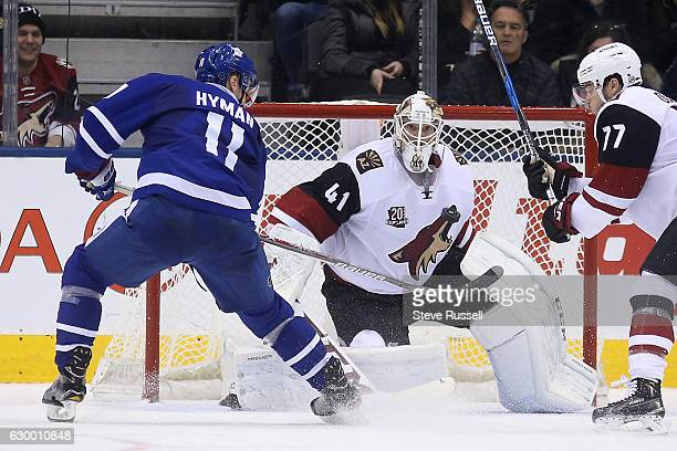TORONTO ON DECEMBER 15 Toronto Maple Leafs center Zach Hyman tries to swipe the puck by Mike Smith as the Toronto Maple Leafs lose to the Arizona...