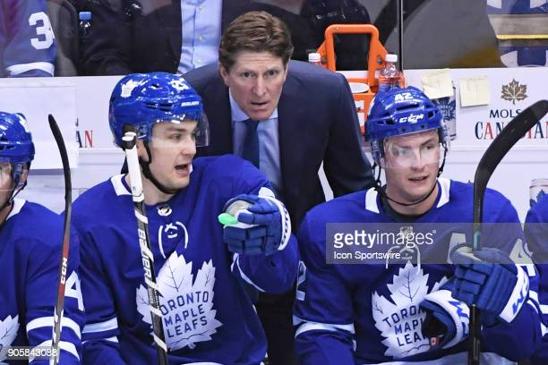 Toronto Maple Leafs coach Mike Babcock talks with Toronto Maple Leafs Left Wing James van Riemsdyk and Center Tyler Bozak on the bench during the...