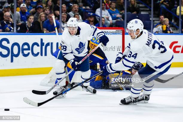 Toronto Maple Leafs' Connor Brown left and Auston Matthews right scramble for a loose puck during the second period of an NHL hockey game between the...