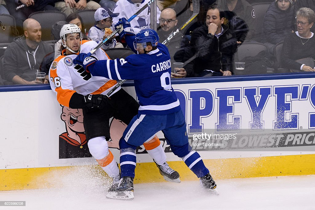 Toronto Maple Leafs Defenceman Connor Carrick (8) checks Philadelphia  Flyers Left Wing Chris VandeVelde 1ff818b1a