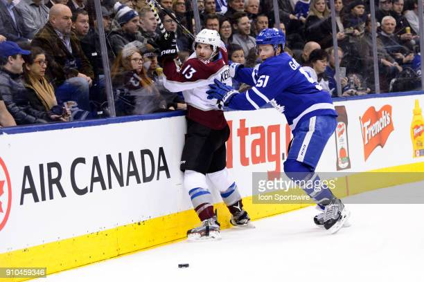 Toronto Maple Leafs Defenceman Jake Gardiner checks Colorado Avalanche Center Alexander Kerfoot into the boards during the first period of the NHL...