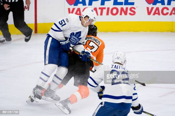 Toronto Maple Leafs Defenceman Jake Gardiner knocks down Philadelphia Flyers Right Wing Wayne Simmonds in the third period during the game between...