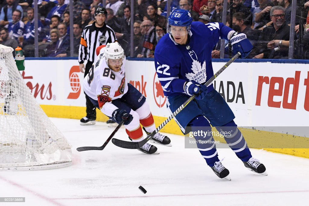 Toronto Maple Leafs Defenceman Nikita Zaitsev (22) is chased by Florida Panthers Left Wing Jamie McGinn (88) as he moves the puck during the regular season NHL game between The Florida Panthers and Toronto Maple Leafs on February 20, 2018 at Air Canada Centre in Toronto, ON.