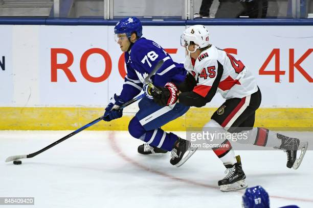 Toronto Maple Leafs Defenceman Timothy Liljegren is chased by Ottawa Senators Forward Parker Kelly during the NHL preseason Rookie Tournament game...