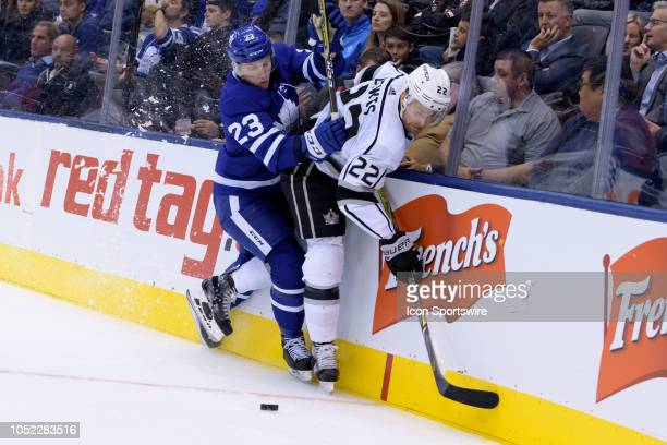 Toronto Maple Leafs Defenceman Travis Dermott checks Los Angeles Kings Right Wing Trevor Lewis into the boards during the NHL regular season game...