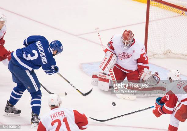 Toronto Maple Leafs defenseman Alexey Marchenko battles for a puck in front of Detroit Red Wings goalie Petr Mrazek during the second period in a...
