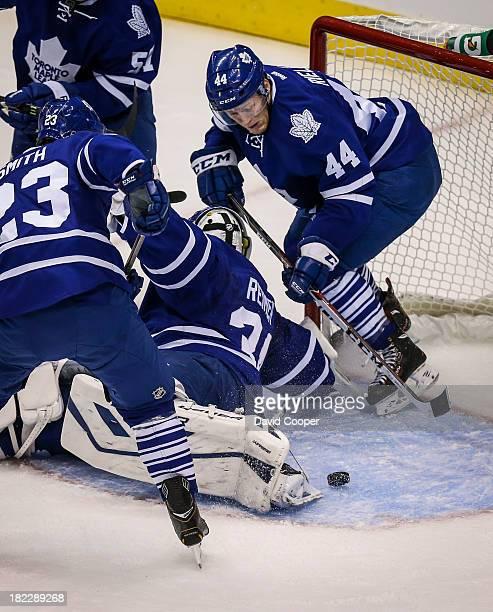 Toronto Maple Leafs defenseman Morgan Rielly in behind Toronto Maple Leafs goalie James Reimer during the game as the Toronto Maple Leafs defeated...