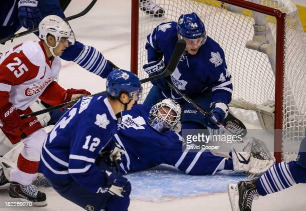 TORONTO ON SEPTEMBER 28 Toronto Maple Leafs defenseman Morgan Rielly in behind Toronto Maple Leafs goalie James Reimer during the game as the Toronto...