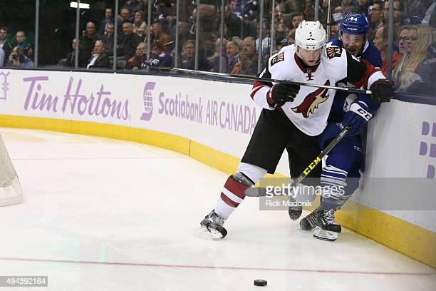 Toronto Maple Leafs defenseman Morgan Rielly is pinned against the boards by Arizona Coyotes defenseman Connor Murphy Toronto Maple Leafs V Arizona...
