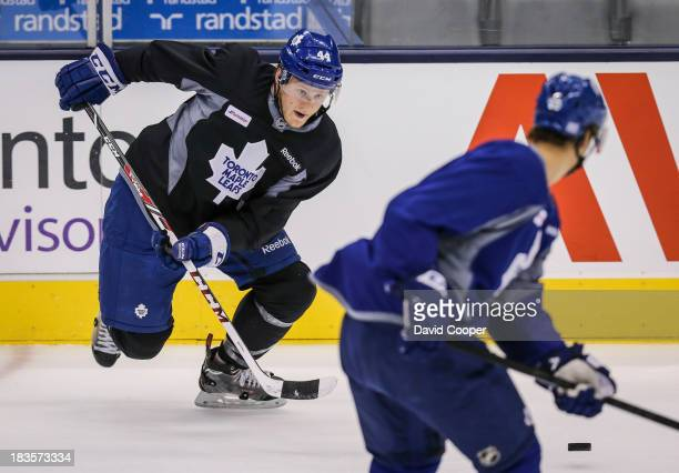Toronto Maple Leafs defenseman Morgan Rielly makes an outlet pass during practice at the Air Canada Centre in Toronto, October 7, 2013.