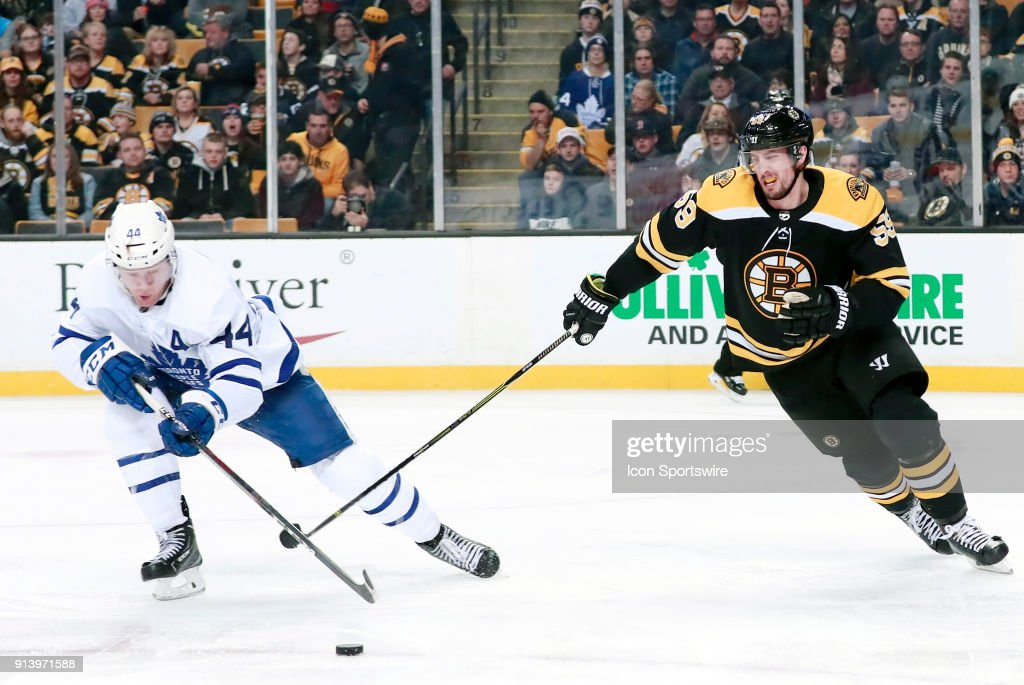 Toronto Maple Leafs defenseman Morgan Rielly (44) takes the puck back from Boston Bruins center Tim Schaller (59) during a game between the Boston Bruins and The Toronto Maple Leafs on February 3, 2018, at TD Garden in Boston, Massachusetts. The Bruins defeated the Maple Leafs 4-1.