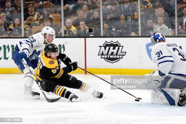 Toronto Maple Leafs defenseman Travis Dermott spills Boston Bruins center Karson Kuhlman during Game 1 of the First Round between the Boston Bruins...