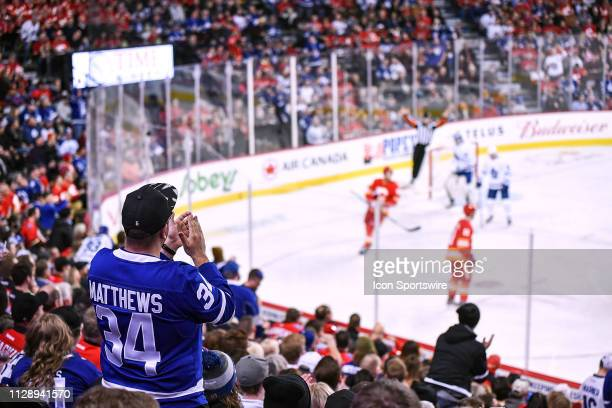 Toronto Maple Leafs fan wearing a Toronto Maple Leafs Center Auston Matthews jersey cheers during the second period of an NHL game where the Calgary...