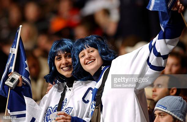 Toronto Maple Leaf's fans cheer on their team against the Atlanta Thrashers during the game at Air Canada Centre on October 31 2002 in Toronto...